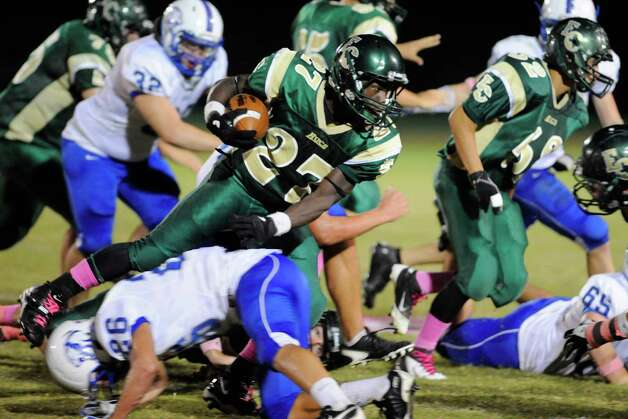 East Chambers running back Glenn Roberts rushes over the Buna defense in the first half of their game at East Chambers High School.  Thursday, October 27, 2011.  Valentino Mauricio/The Enterprise Photo: Valentino Mauricio