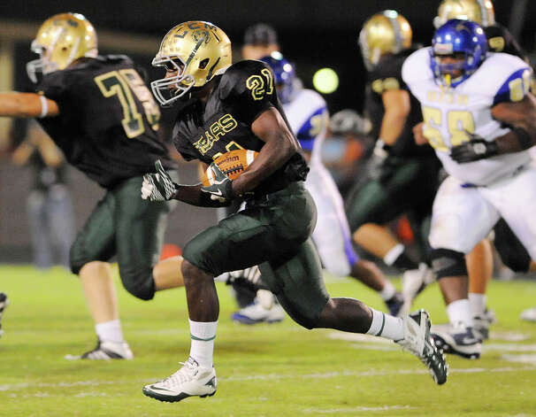 The Little Cypress-Mauriceville running back Alex Sezer (21) rushes against the Panthers defense in the first half of their district game at Bear Stadium. Friday,  September 30, 2011.  Valentino Mauricio/The Enterprise Photo: Valentino Mauricio
