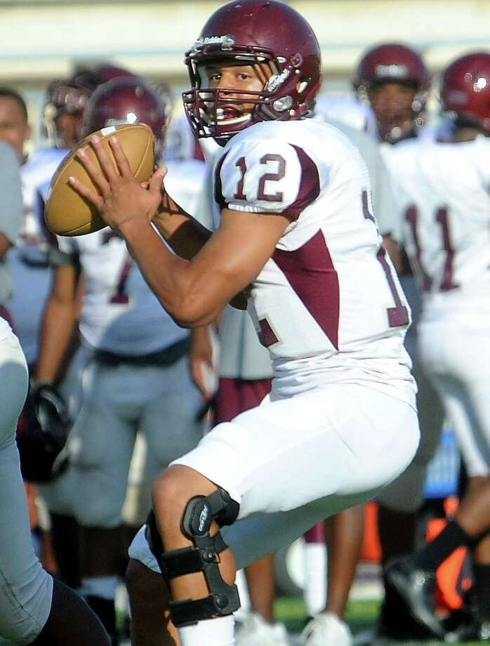 Central's Robert Mitchell looks to pass during the Maroon/White game at the BISD Thomas Center in Beaumont, Wednesday, May 23, 2012. Tammy McKinley/The Enterprise Photo: TAMMY MCKINLEY