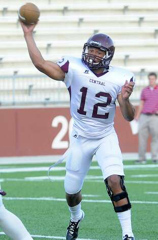 Robert Mitchell looks to pass during Central's Spring Game at the BISD Thomas Center in Beaumont, Wednesday, May 23, 2012. Tammy McKinley/The Enterprise Photo: TAMMY MCKINLEY