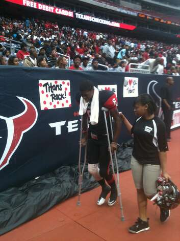 Port Arthur Memorial receiver John Leday limps off the field in crutches. He suffered an injury on Memorial's first offensive play of the game at Reliant Stadium Saturday. Photo: David Henry
