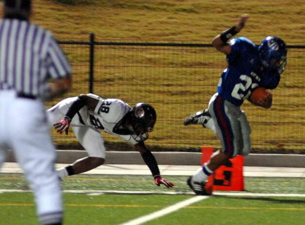 Memorial sophomore defensive back Darius Lemora attempts to take down West Brook senior running back Dylan Harvey during the first half. Beth Rankin/The Enterprise