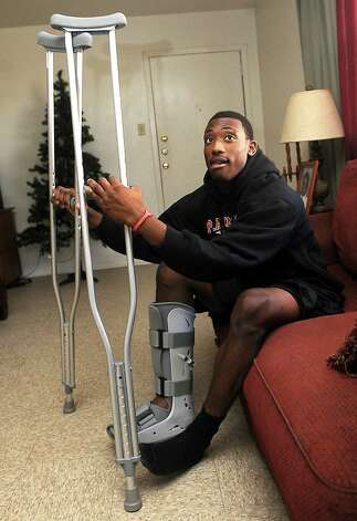 Memorial's safety Darius Lemora recovers from a broken leg at home as the team practices at Memorial Stadium in Port Arthur, Wednesday, December 7, 2011. Tammy McKinley/The Enterprise Photo: TAMMY MCKINLEY