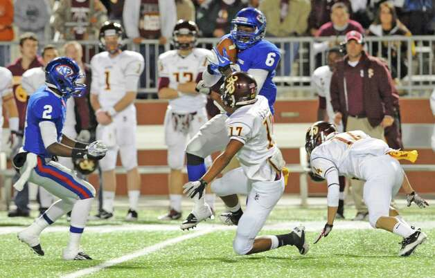 "West Brook #6, Ladarious Spearman, center, catches a pass despite  Deer Park #17, D. J. Lasua's attempt to block it in first half action at the Carrol A ""Butch"" Thomas Educational Support Center.   The West Brook Bruins lost the game 31-30.  Dave Ryan/The Enterprise Photo: Dave Ryan"
