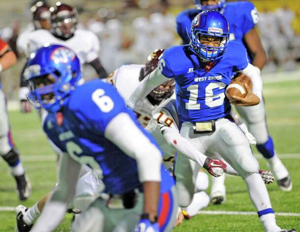 "West Brook #16, Jalen Malone, tries to keep running behind #6, Ladarious Spearman, while Deer Park's #19, Jeremy Halling, tries to pull him down by his legs in first half action at the Carrol A ""Butch"" Thomas Educational Support Center.   The West Brook Bruins lost the game 31-30.  Dave Ryan/The Enterprise Photo: Dave Ryan"