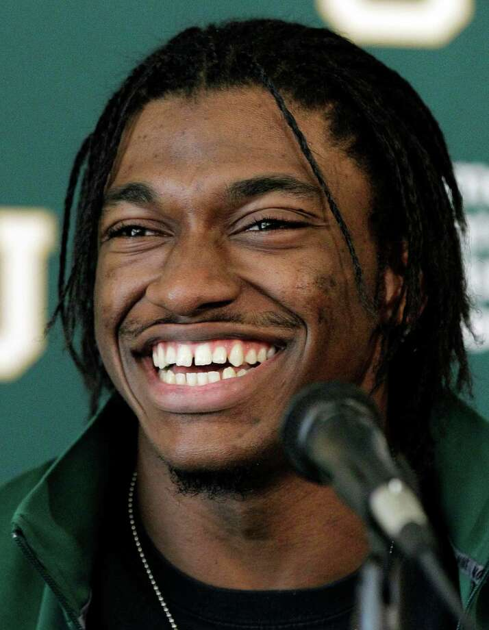 Heisman Trophy winner Robert Griffin III smiles after announcing that he will skip his senior season and enter the NFL draft during a news conference, Wednesday, Jan. 11, 2012, in Waco, Texas. Photo: AP