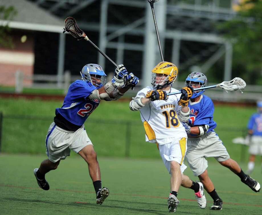 Matthew Brooks, 18, controls the ball for Weston in a Class S playoff game against Tolland. Brooks was a First Team All-SWC selection and plans on playing club lacrosse for Stonehill College. Photo: Autumn Driscoll, Autumn Driscoll/Staff Photographer / Connecticut Post