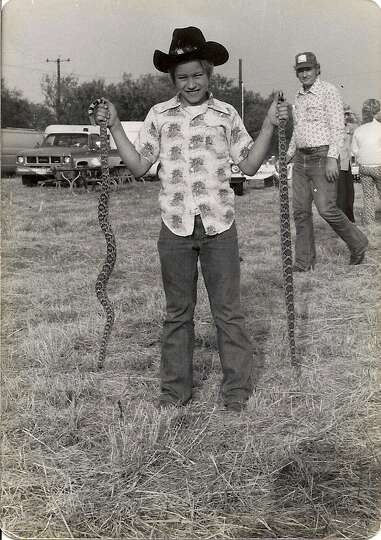 Trey Gray, 10. holds two rattlesnakes that were killed during a San Antonio Weimaraner Club Field Tr