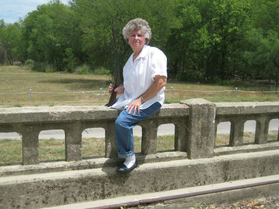 Now: Frances Kunze Wise sits on the historic Bergs Mill Bridge in east Bexar County in 2009, 60 years after she posed on the same bridge. Photo: Courtesy