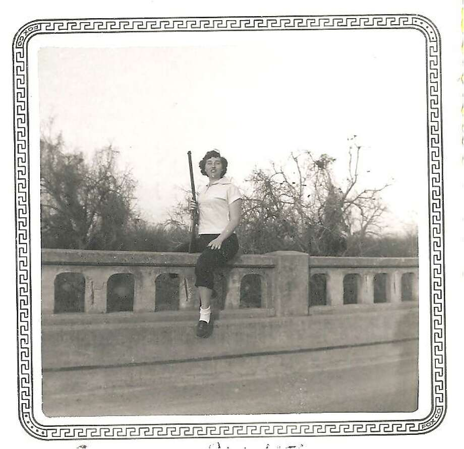 Frances Kunze Wise sits on the historic Bergs Mill Bridge in east Bexar County in 1949. Soldiers who landed at Stinson Field during WWII were marched across this bridge on their way to Brooks Field. Photo: Courtesy