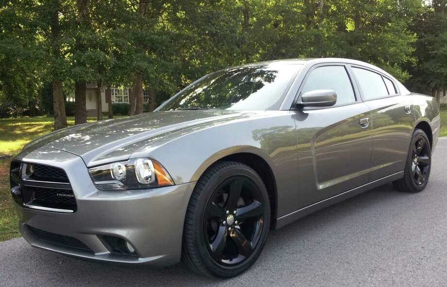 The 2012 Dodge Charger is a sporty and stylish big sedan that seems a lot more expensive than it is. It has a powerful base V-6 engine that offers great performance and decent fuel economy, and the cabin is quieter at highway speeds than even many high-end luxury cars. Photo: G. Chambers Williams III/For The Express-News