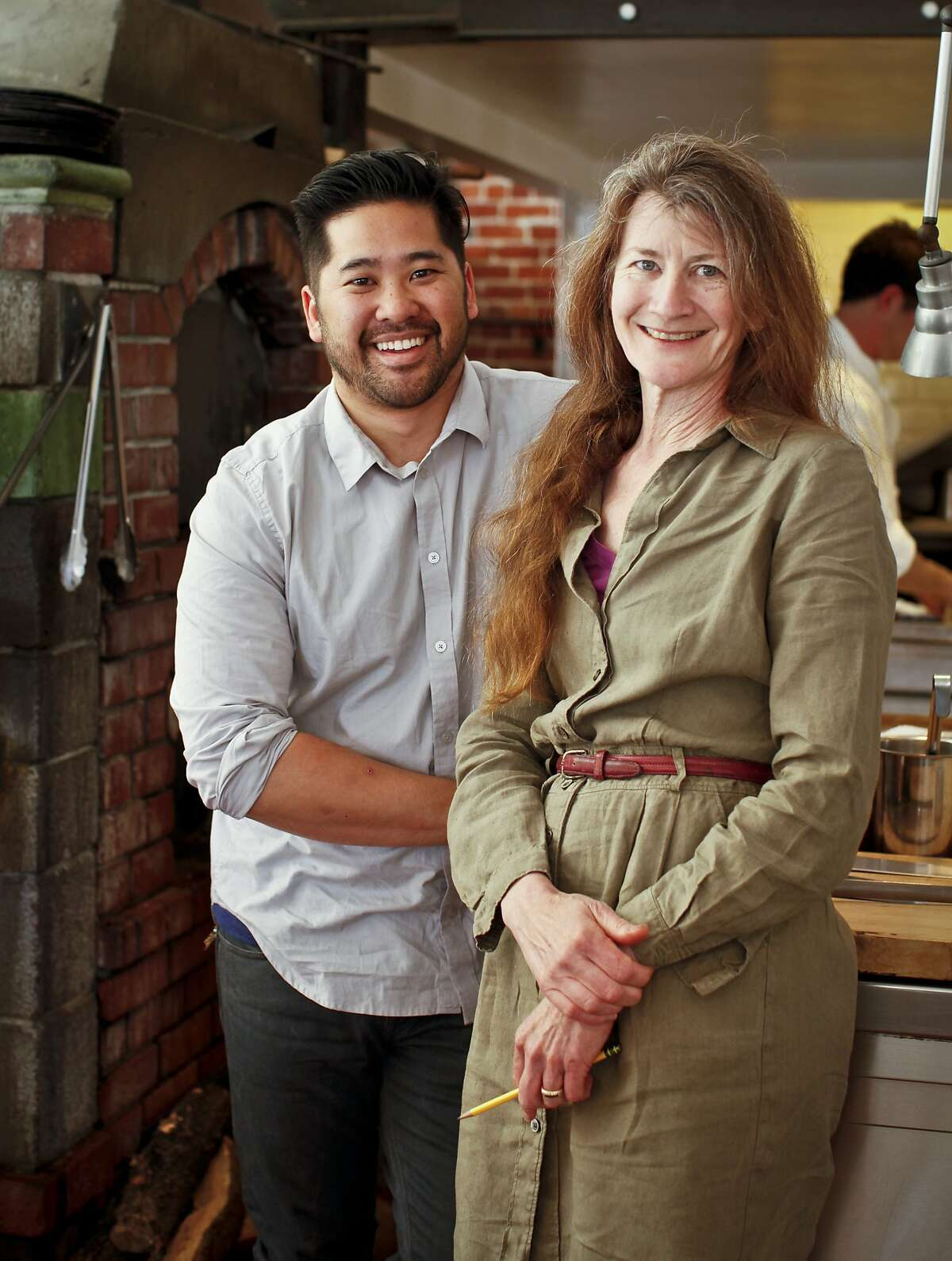 Brandon Jew, left, chef at Bar Agricole, says mentoring by Judy Rodgers of Zuni, both seen at Zuni on Wednesday, June 13, 2012 in San Francisco, Calif., has been a major factor for his success in the kitchen.