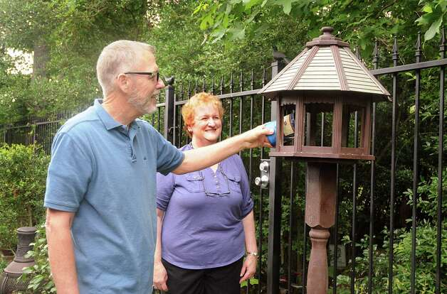 Master Naturalist Ken Kramm and his wife Deb add animal feed to a feeder at his certified and award-winning wildlife garden at their home in Windsor Hills in The Woodlands. The trees and plants in the habitat attract birds and small animals that make the habitat their home. Photo: David Hopper / freelance
