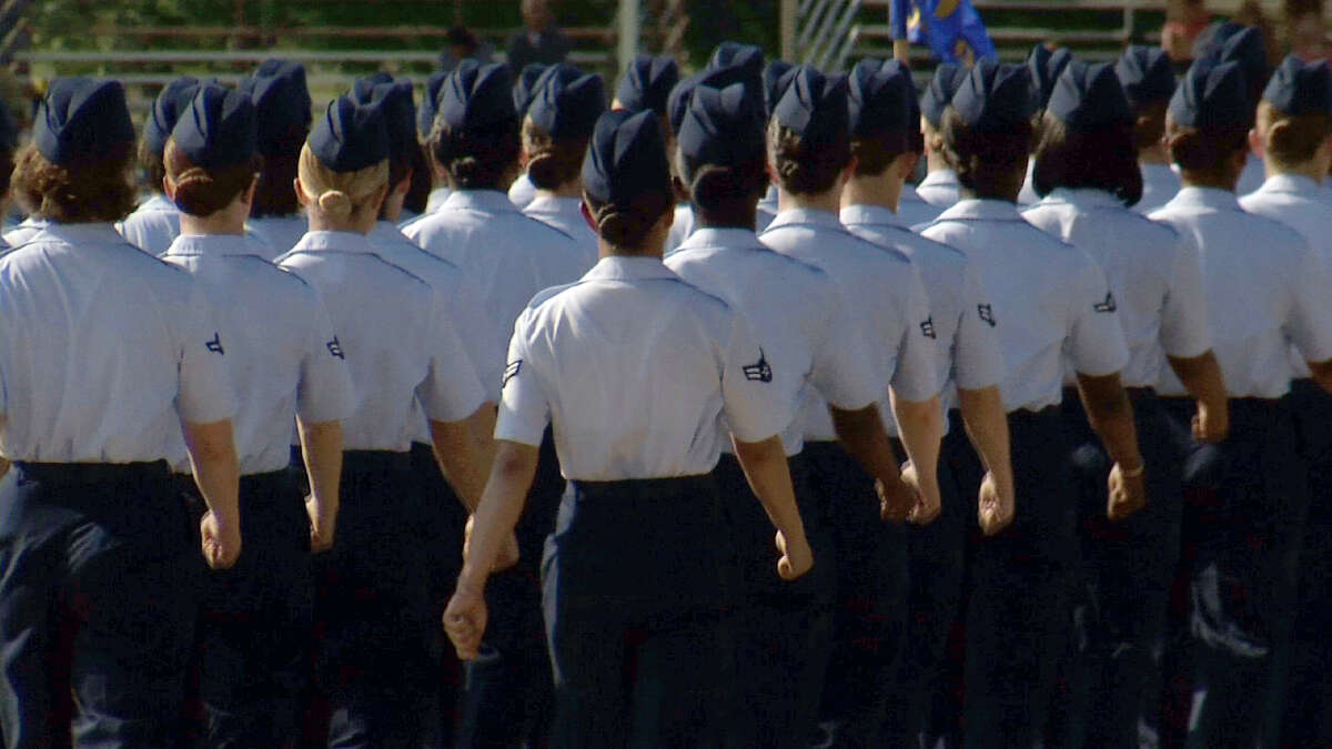 In this June 22, 2012, image made from video, female airmen march during graduation at Lackland Air Force Base in San Antonio. A widening sex scandal has rocked Lackland Air Force Base in Texas, one of the nation's busiest military training centers, where four male instructors are charged with having sex with, and in one case raping, female trainees.