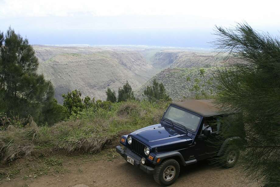 There are only a few paved roads on Lanai, so to really explore the island a visitor needs a four-wheel-drive vehicle. Photo: Eric Noland