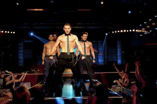 "This film image released by Warner Bros. shows, from left, Adam Rodriguez, Kevin Nash, Channing Tatum, and Matt Bomer in a scene from ""Magic Mike."" Photo: AP"