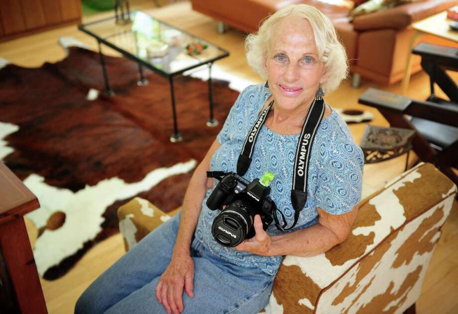 Frances Gallogly poses for a photograph at her home in Trumbull, Conn. Gallogly and her husband, Vin, took a four-week trip to Namibia for her 70th birthday and their 50th wedding anniversary and created a photography book, which is now for sale.  Gallogly began studying photography in her retirement and became inspired by photographs of the Namibian landscape. Photo: Autumn Driscoll / Connecticut Post