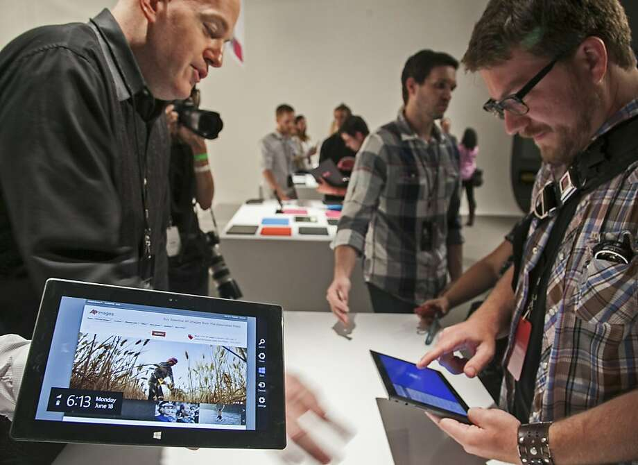 Sales of Microsoft's Surface tablets kicked off Tuesday. The order site has removed the guarantee of Oct. 26 delivery for the lowest-end version, indicating that the $499 model of the device has sold out. Photo: Damian Dovarganes, Associated Press