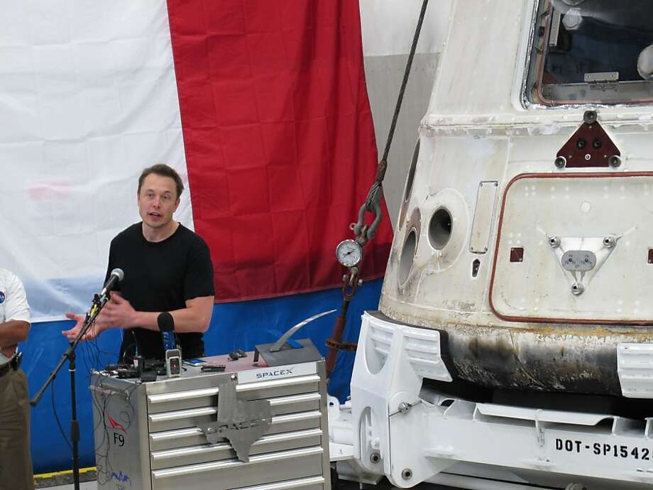 SpaceX's Elon Musk talks about the Dragon capsule that resupplied the International Space Station. Photo: Angela K. Brown, Associated Press