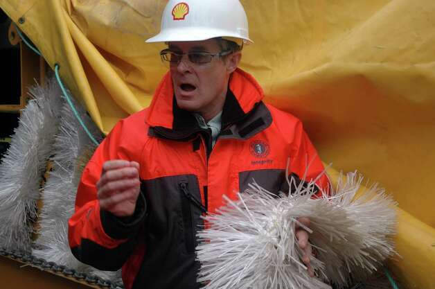 Geoff Merrell, superintendent of emergency response for Shell Alaska, holds white skimmer brushes. Photo: Jennifer A. Dlouhy, The Houston Chronicle