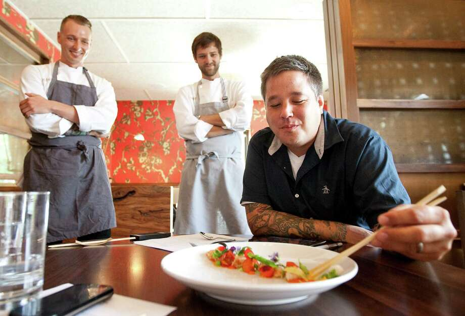 Philip Speer, director of Uchi's culinary operations, tastes a peas, carrots and prawns dish.  made by Uchi sou chef Page Pressley, back left, during an in-house evaluation, Friday, June 15, 2012, in Houston. ( Nick de la Torre / Houston Chronicle ) Photo: Nick De La Torre / © 2012  Houston Chronicle