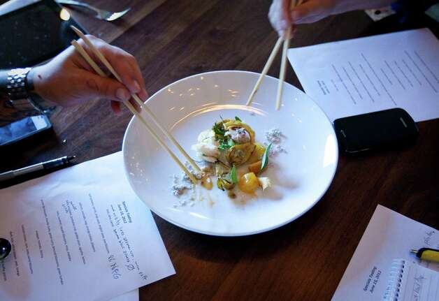 Uchi Japanese restaurant tasters try dishes made for an in-house evaluation by Philip Speer, director of culinary operations, Friday, June 15, 2012, in Houston. ( Nick de la Torre / Houston Chronicle ) Photo: Nick De La Torre / © 2012  Houston Chronicle