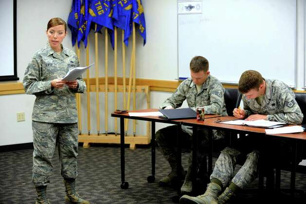 Air Force Tech. Sgt. Chrissie Slifer, a military training instructor, offers instruction at Lackland Air Force Base on June 11, 2012. Photo: Billy Calzada, San Antonio Express-News / © 2012 San Antonio Express-News