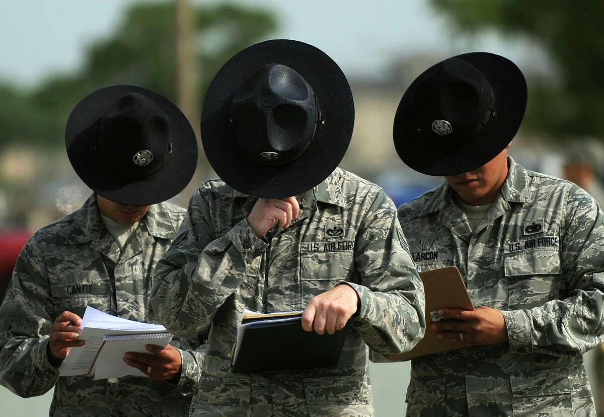Military Training Instructors, or MTIs, grade a candidate during MTI training at Lackland Air Force Base on June 11, 2012.