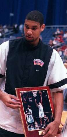 NBA Rookie of the Month Spurs foward Tim Duncan receives his award before the game against the Minnesota Timberwolves on Feb. 24 1998 in San Antonio. (AP Photo/Charles Barksdale) (AP)