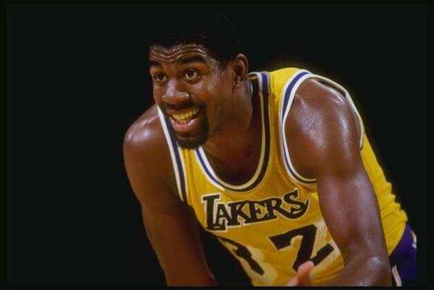 Guard Magic Johnson of the Los Angeles Lakers stands on the court during a game at the Great Western Forum in Inglewood, California.  (Getty Images / Getty Images)