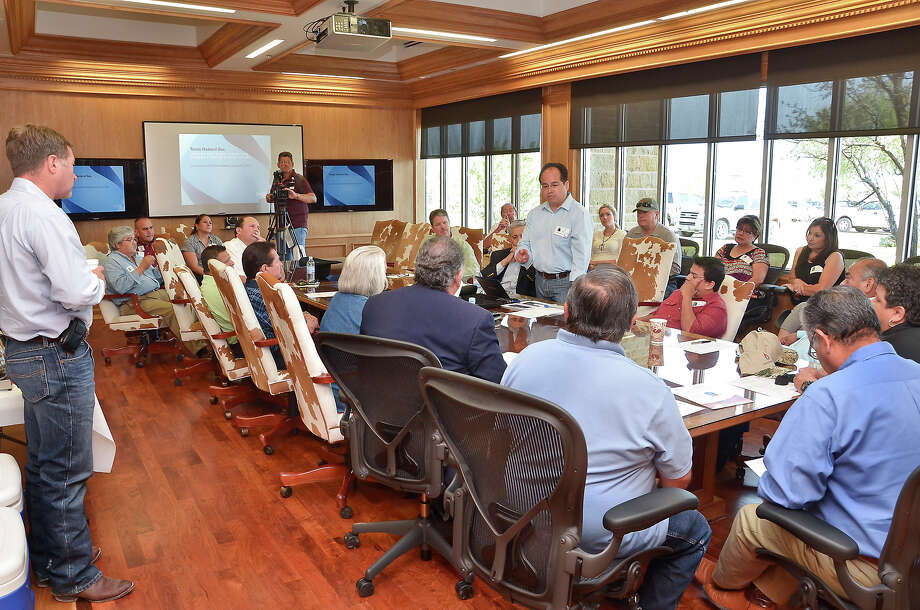 Jose L. Ceballos, standing at right, an Eagle Ford Shale consultant for America's Natural Gas Alliance (ANGA) was one of the presenters Tuesday in Encinal  where the Lewis Energy Group hosted a tour of their newly-expanded Operations Center. Photo: CUATE SANTOS / LAREDO MORNING TIMES