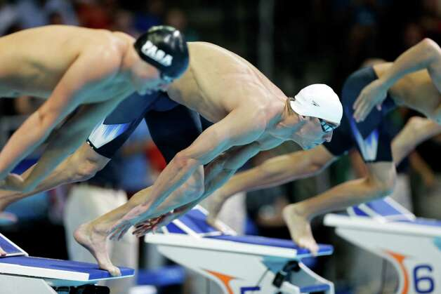 Michael Phelps dives in the men's 400-meter individual medley preliminaries at the U.S. Olympic swimming trials, Monday, June 25, 2012, in Omaha, Neb. (AP Photo/David Phillip) Photo: Associated Press
