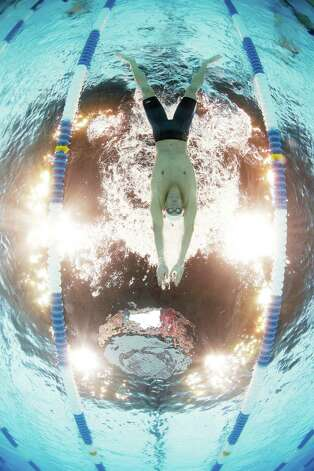 Michael Phelps swims in the men's 400-meter individual medley preliminaries at the U.S. Olympic swimming trials, Monday, June 25, 2012, in Omaha, Neb. (AP Photo/David Phillip) Photo: Associated Press