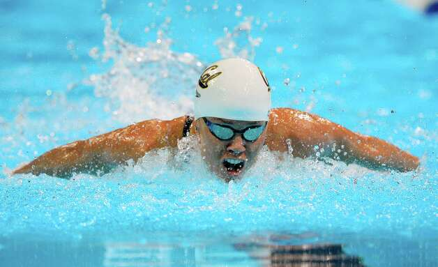 Natalie Coughlin swims in the women's 100-meter butterfly preliminaries at the U.S. Olympic swimming trials, Monday, June 25, 2012, in Omaha, Neb. (AP Photo/Mark J. Terrill) Photo: Associated Press