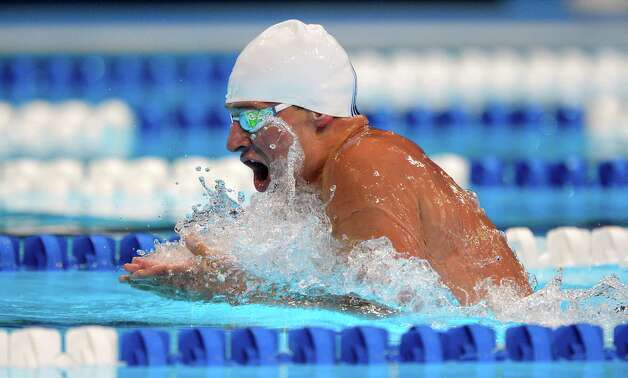 Ryan Lochte swims in the men's 400-meter individual medley preliminaries at the U.S. Olympic swimming trials, Monday, June 25, 2012, in Omaha, Neb. (AP Photo/Mark J. Terrill) Photo: Associated Press