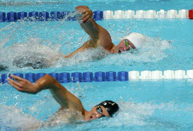 Peter Vanderkaay, top, and Michael Klueh compete in the men's 400-meter freestyle preliminaries at the U.S. Olympic swimming trials, Monday, June 25, 2012, in Omaha, Neb. (AP Photo/Mark Humphrey) Photo: Associated Press