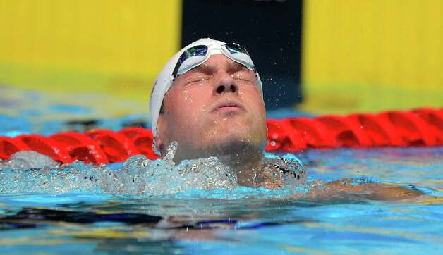 Peter Vanderkaay leaves his lane after swimming in the men's 400-meter freestyle preliminaries at the U.S. Olympic swimming trials, Monday, June 25, 2012, in Omaha, Neb. (AP Photo/Mark J. Terrill) Photo: Associated Press