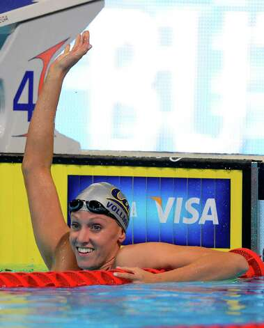 Dana Vollmer waves after swimming in the women's 100-meter butterfly preliminaries at the U.S. Olympic swimming trials, Monday, June 25, 2012, in Omaha, Neb. (AP Photo/Mark J. Terrill) Photo: Associated Press