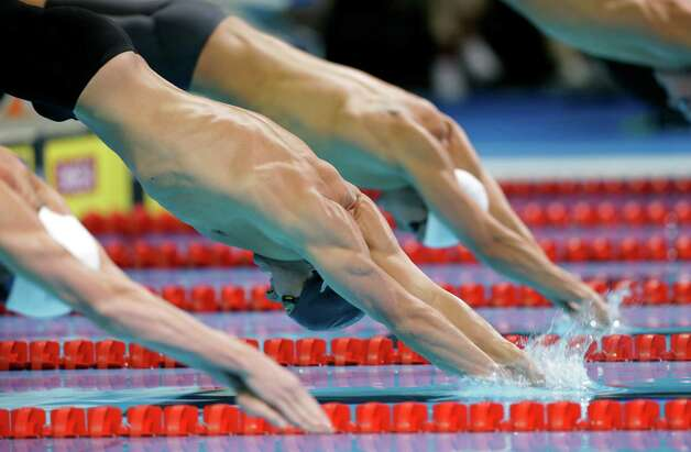 Brendan�Hansen, center, dives in the men's 100-meter breaststroke preliminaries at the U.S. Olympic swimming trials, Monday, June 25, 2012, in Omaha, Neb. (AP Photo/David Phillip) Photo: Associated Press