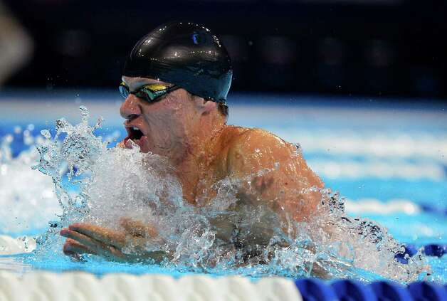 Brendan�Hansen swims in the men's 100-meter breaststroke preliminaries at the U.S. Olympic swimming trials, Monday, June 25, 2012, in Omaha, Neb. (AP Photo/Mark J. Terrill) Photo: Associated Press