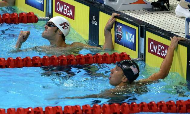 John Criste pumps his fist after swimming in the men's 100-meter breaststroke preliminaries at the U.S. Olympic swimming trials, Monday, June 25, 2012, in Omaha, Neb. At right is Mark Gangloff. (AP Photo/Mark Humphrey) Photo: Associated Press