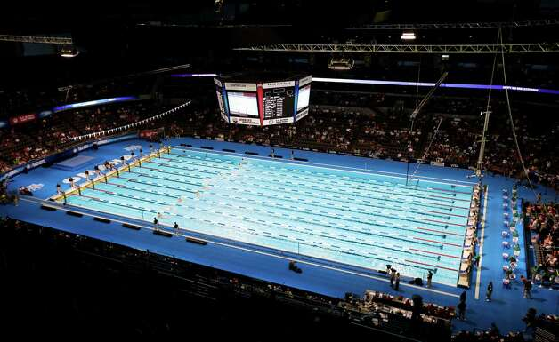 Swimmers compete in the men's 100-meter breaststroke preliminaries at the U.S. Olympic swimming trials, Monday, June 25, 2012, in Omaha, Neb. (AP Photo/Mark Humphrey) Photo: Associated Press