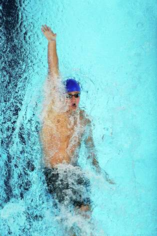 Ryan Lochte swims in the men's 400-meter individual medley final at the U.S. Olympic swimming trials, Monday, June 25, 2012, in Omaha, Neb. (AP Photo/Mark Humphrey) Photo: Associated Press