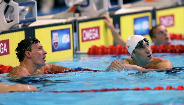 Ryan Lochte, left, and Michael Phelps look at the time after finishing in the men's 400-meter individual medley final at the U.S. Olympic swimming trials, Monday, June 25, 2012, in Omaha, Neb. (AP Photo/David Phillip) Photo: Associated Press