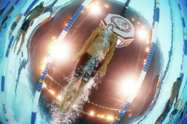 Mike�Alexandrov swims in the men's 100-meter breaststroke preliminaries at the U.S. Olympic swimming trials, Monday, June 25, 2012, in Omaha, Neb. (AP Photo/David Phillip) Photo: Associated Press