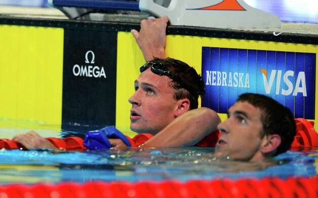 Ryan Lochte, left, and Michael Phelps watch the results in the men's 400-meter individual medley final at the U.S. Olympic swimming trials, Monday, June 25, 2012, in Omaha, Neb.  Lochte won the race. (AP Photo/Mark J. Terrill) Photo: Associated Press