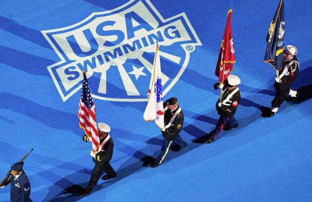 A military color guard performs at the U.S. Olympic swimming trials, Monday, June 25, 2012, in Omaha, Neb. (AP Photo/The World-Herald, Alyssa Schukar) MAGS OUT; ALL NEBRASKA LOCAL BROADCAST TV OUT Photo: Associated Press