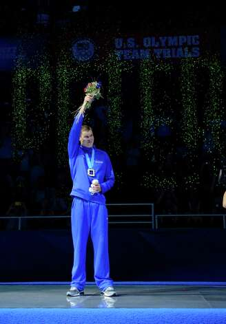 Peter Vanderkaay waves to the crowd during the medal ceremony after winning the men's 400-meter freestyle final at the U.S. Olympic swimming trials, Monday, June 25, 2012, in Omaha, Neb. (AP Photo/Mark J. Terrill) Photo: Associated Press