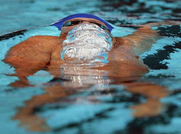 Ryan Lochte swims the backstroke in the men's 400-meter individual medley final at the U.S. Olympic swimming trials, Monday, June 25, 2012, in Omaha, Neb.  Lochte won the race.   (AP Photo/The Omaha World-Herald/Matt Miller)  MAGS OUT TV OUT Photo: Associated Press