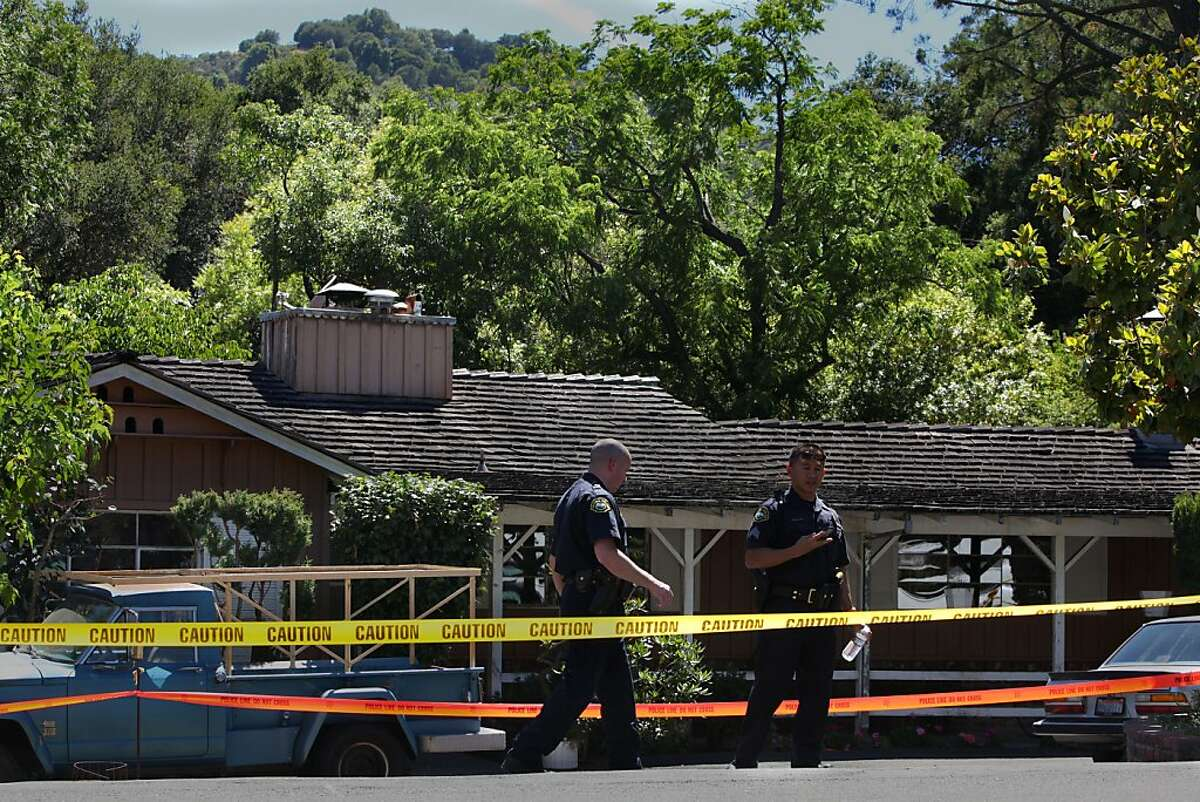 A 51-year-old woman was reported dead around noon today in the kitchen of her residence at 626 Moraga Way in Orinda, Calif., as police investigate the home on Tuesday, June 26, 2012. A 62-year-old male suspect was arrested shortly thereafter.